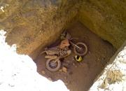 109.dakar bike rests in peace after crashing into tomb